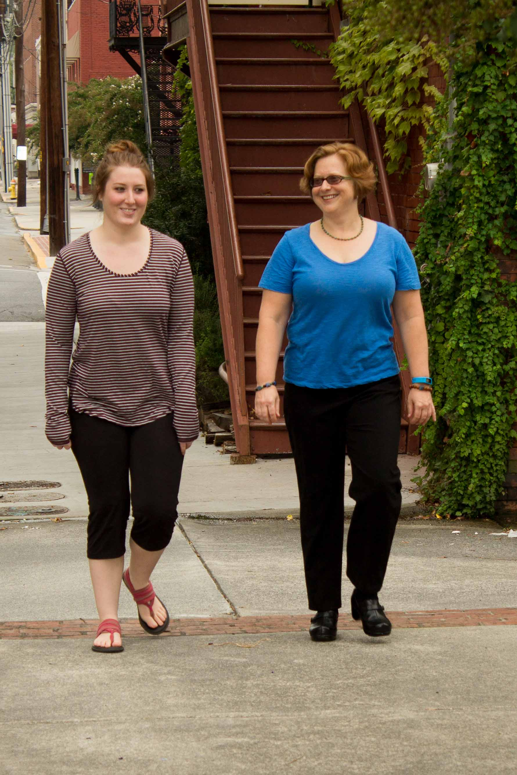 Ellen Thompson and client walking during a counseling session